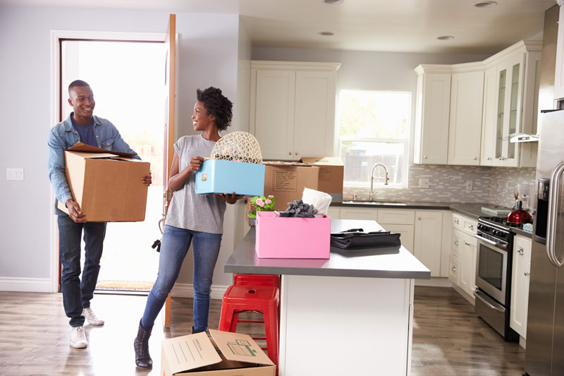two people moving into a new home