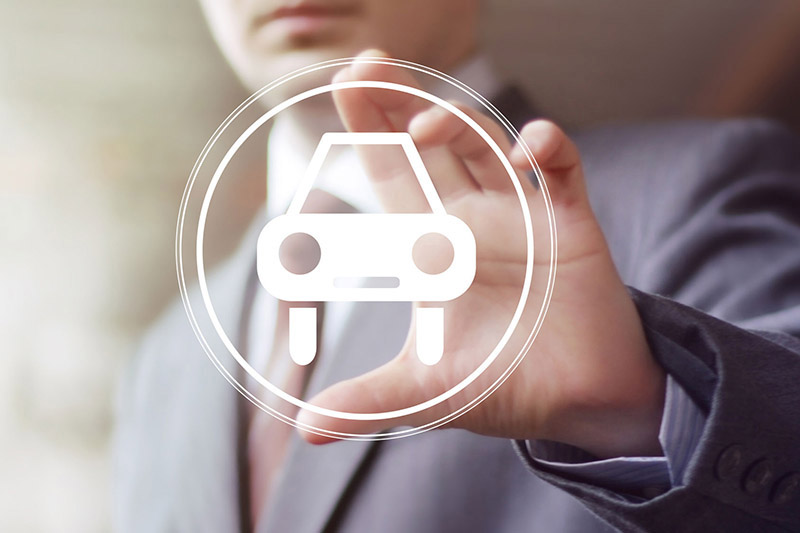 man holding a car insurance icon